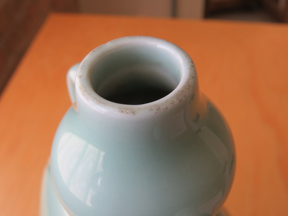 A Chinese Celadon Glazed Porcelain Moon Flask. - 8
