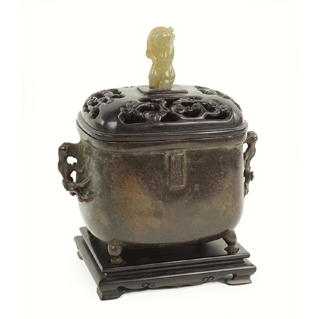 A Chinese Patinated Bronze Footed Censer.