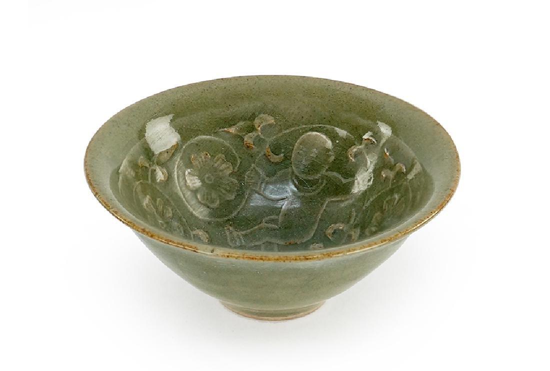 A Celadon Glazed Conical Bowl.