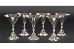 A Set of Six Sterling Silver Goblets.