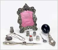 A Collection of Sterling Silver Sewing Items.