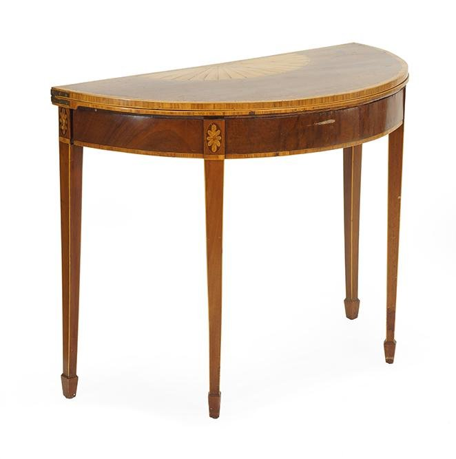 A 19th Century Hepplewhite Demilune Table.