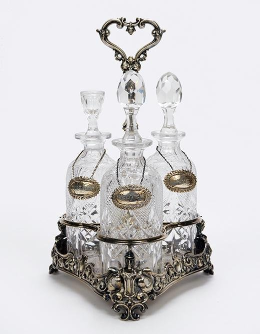 A Late Victorian Silverplate Triple Decanter Stand.