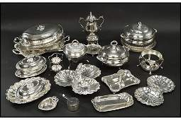 A Collection of Silverplate Serving Pieces.