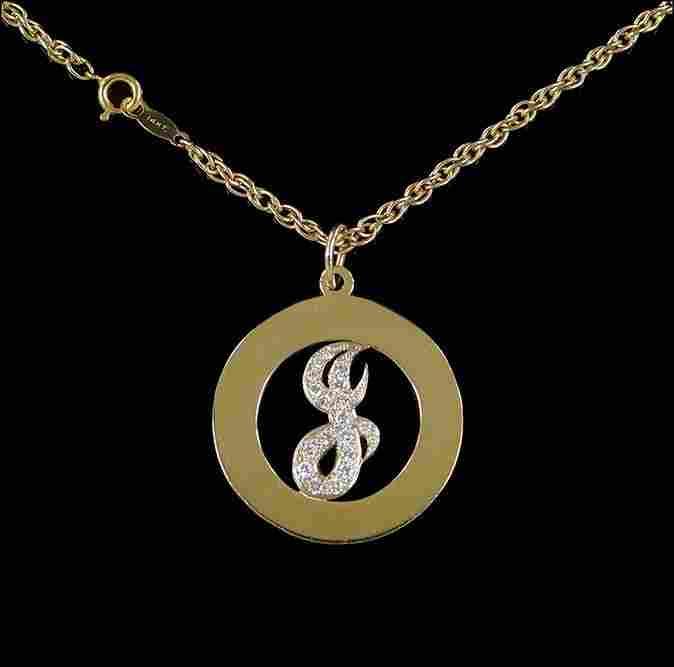 A Diamond Pendant Necklace.