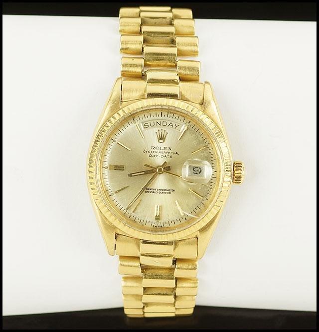 A Man's 18 Karat Yellow Gold Rolex Watch.