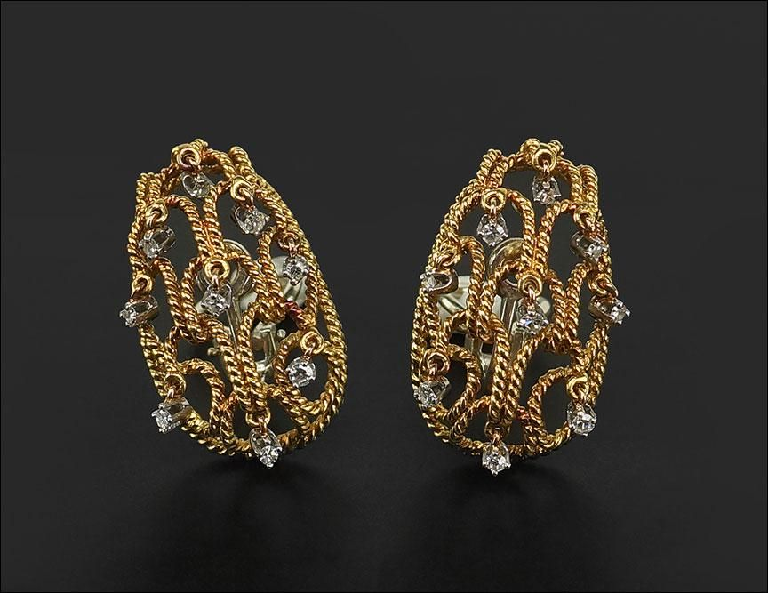 A Pair of Diamond Earclips.