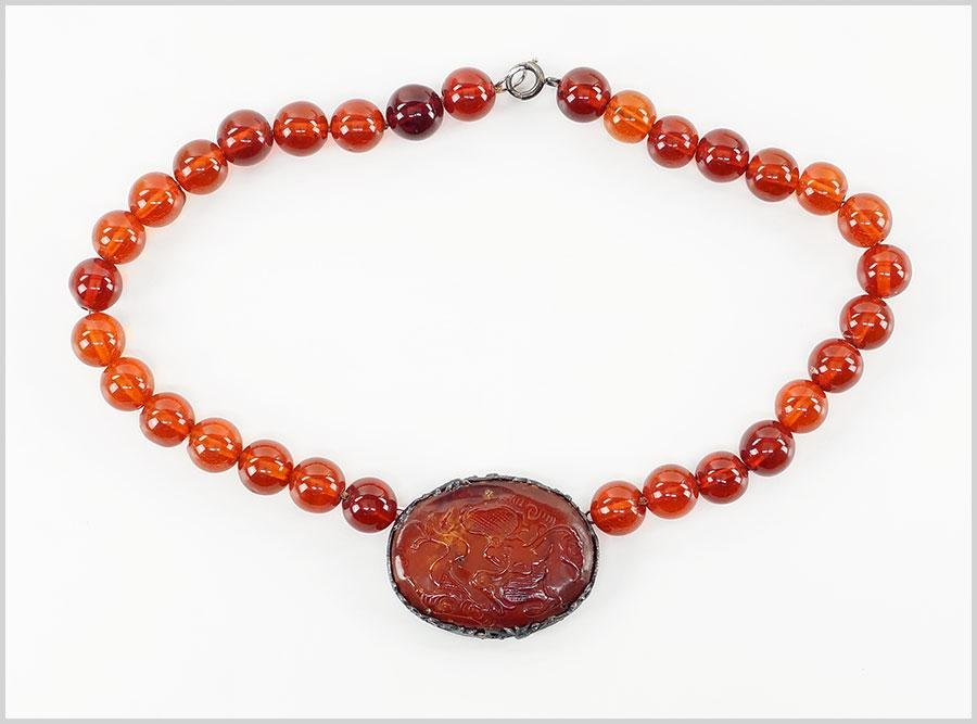 A Chinese Amber Necklace.