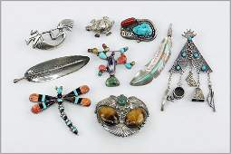 A Collection of Sterling Silver Brooches