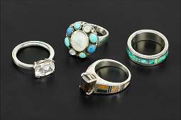 Four Sterling Silver Rings.