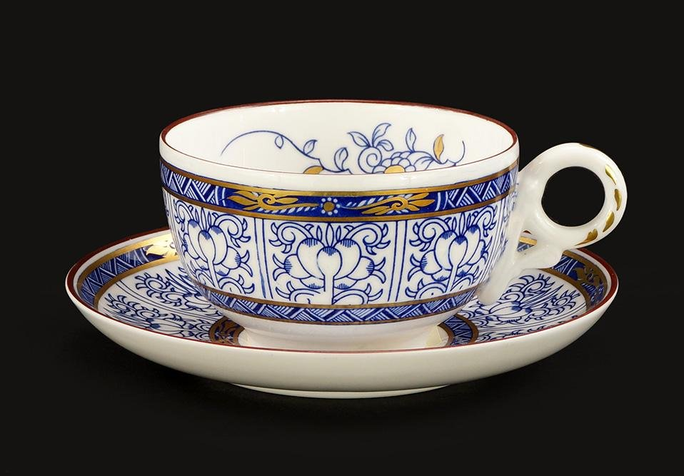 A Set of Royal Worcester Porcelain Cups and Saucers in