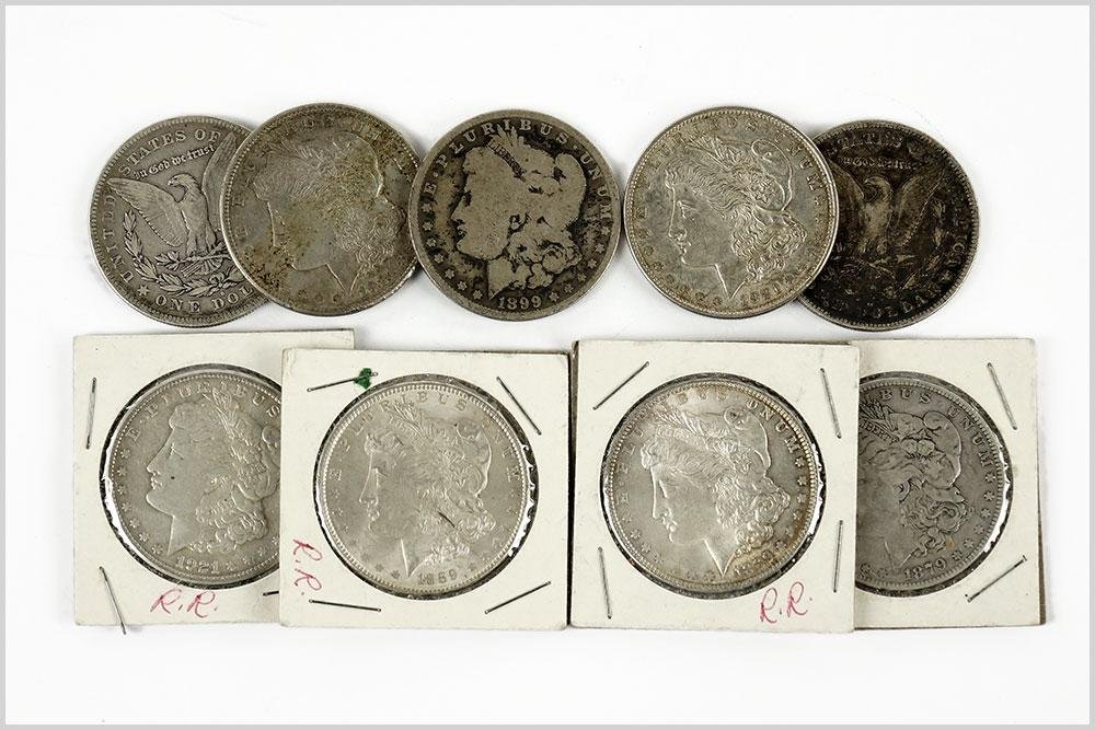 Nine Morgan Silver Dollars.