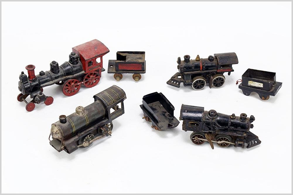 Group of Cast Iron Wind Up Trains.