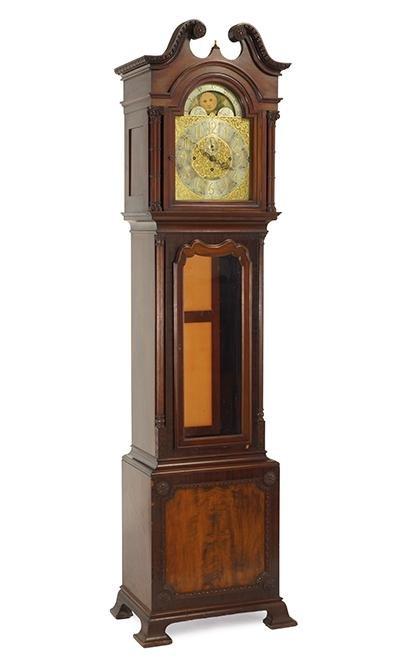 An English Mahogany Tall Case Clock.