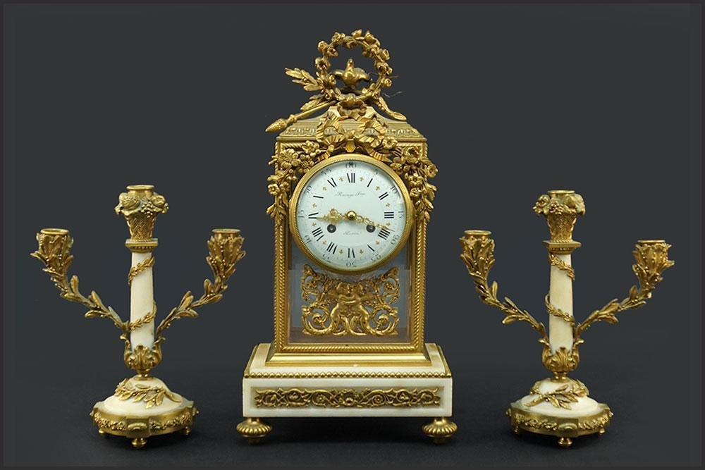 A French Raingo Freres Clock and Garniture Set.