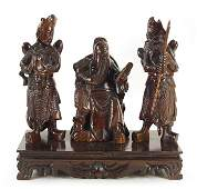 A Chinese Carved Wood Figural Group of Three Immortals.