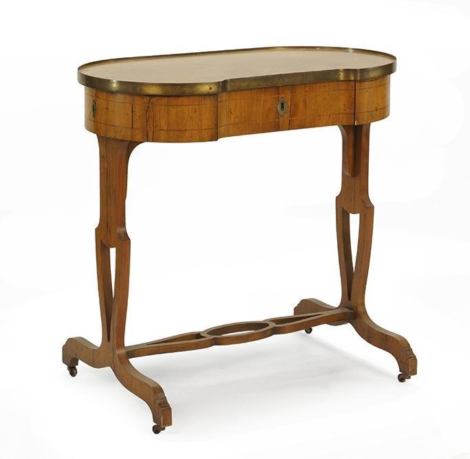 A Baker Kidney Shaped Mahogany Writing Table.