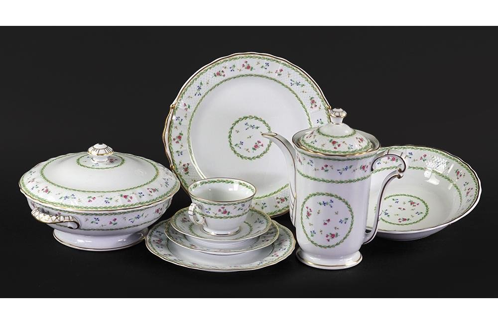 A Limoges Porcelain Partial Dinner Service in the