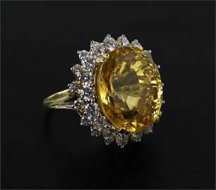 A Yellow Sapphire & Diamond Ring.
