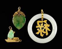 Three Jade and 14 Karat Yellow Gold Pendants.