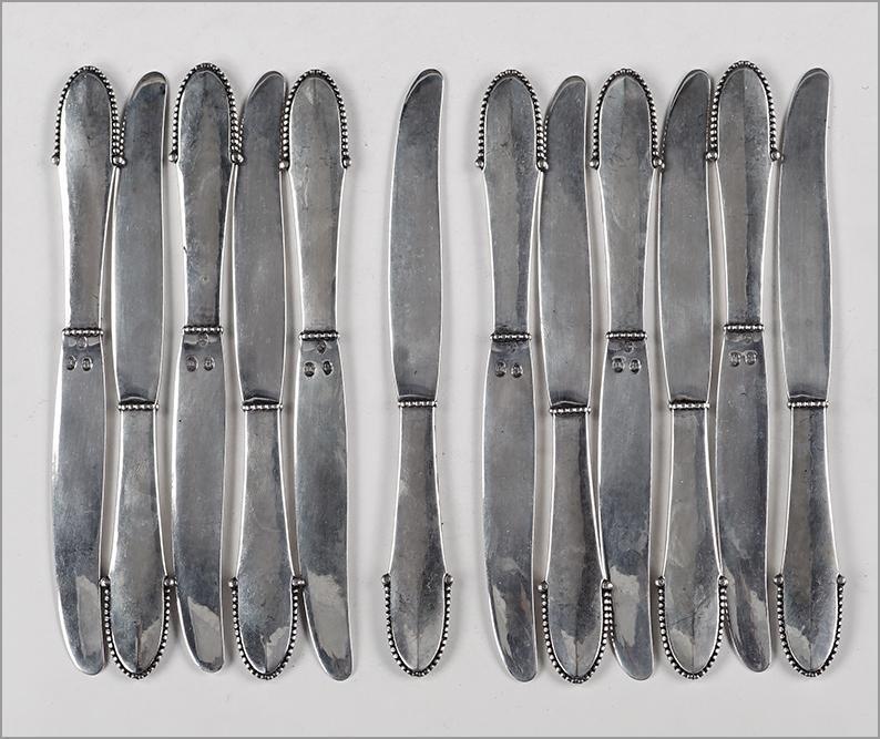 A Set of Twelve Georg Jensen .830 Silver Fruit Knives.