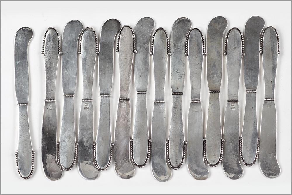 A Set of 14 Georg Jensen Sterling Silver Flat Handle