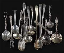 A Collection of Sterling Silver Utensils and Serving