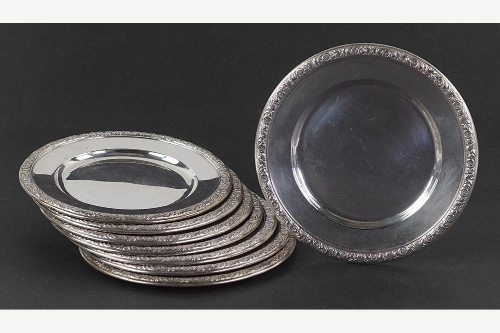 A Set of Eight International Sterling Silver Bread