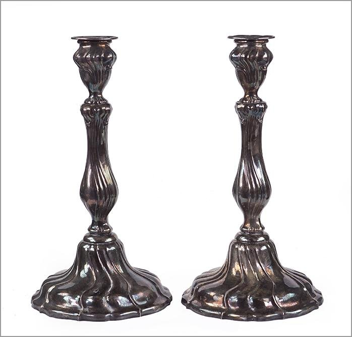 A Pair of Weighted Sterling Silver Candlesticks.