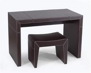 A Leather Clad Vanity Table and Stool.