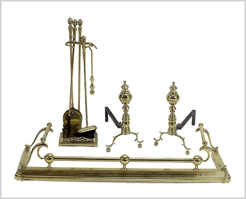 A Suite of Brass Fireplace Accessories.