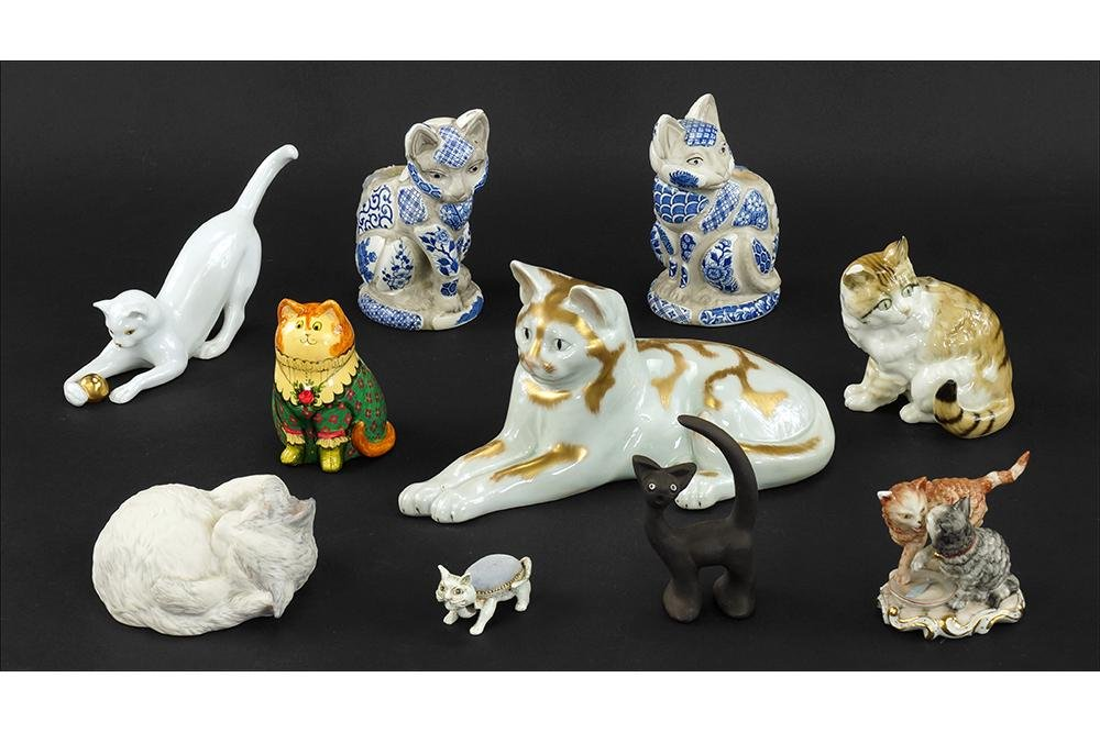 A Group of Ceramic and Porcelain Cat Figurines.