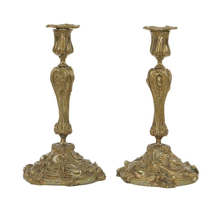 A Pair of Rococo Style Gilt Metal Candlesticks.