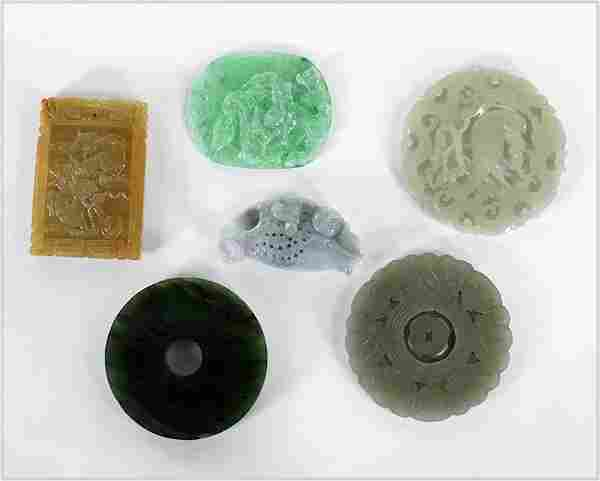 A Collection of Chinese Carved Stone Pendants.