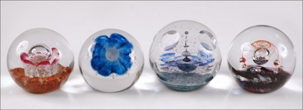 698068: FOUR SELKIRK PAPERWEIGHTS.