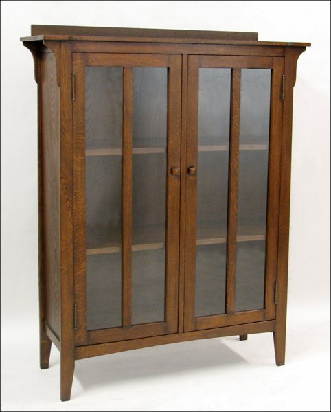 701003: MISSION STYLE OAK AND GLASS CABINET.