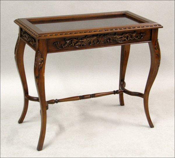 701007: WALNUT VITRINE TABLE.