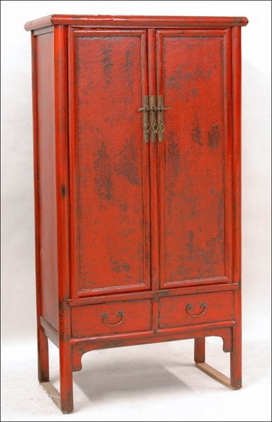701027: CHINESE MING STYLE RED LACQUER CABINET.