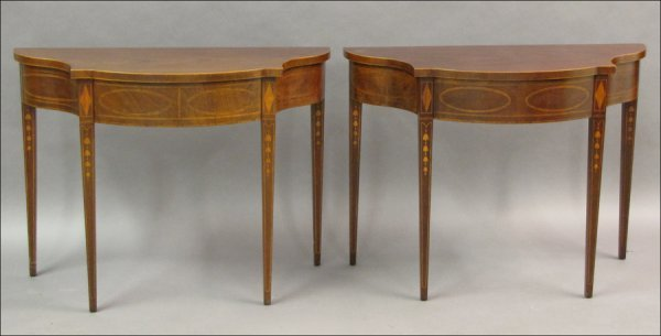 731004: PAIR OF BAKER INLAID MAHOGANY DEMILUNE TABLES.