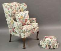 731166: FLORAL UPHOLSTERED WINGBACK ARMCHAIR.