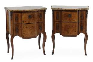 A Pair of French Louis XV Style Commodes.