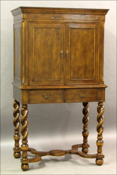 741004: WILLIAM AND MARY STYLE WALNUT CABINET ON STAND.