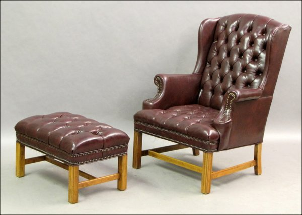 741014: LEATHER WINGBACK CHAIR WITH NAILHEAD TRIM.