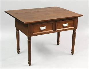 CARVED OAK TWO DRAWER TABLE.