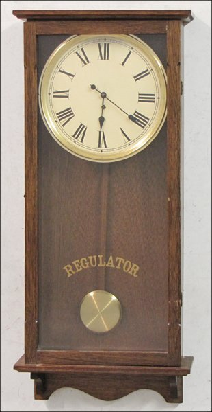 752014: EALY TO MID 20TH CENTURY CARVED OAK WALL CLOCK.
