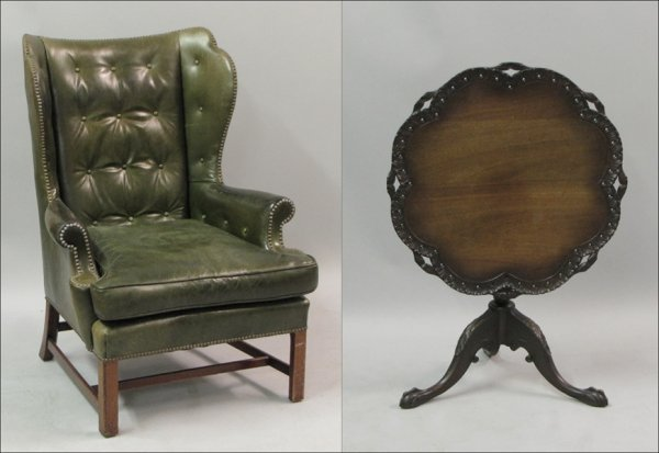 761022: LEATHER UPHOLSTERED WINGBACK LIBRARY CHAIR.