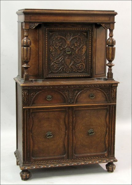 761023: CARVED WALNUT CUPBOARD.