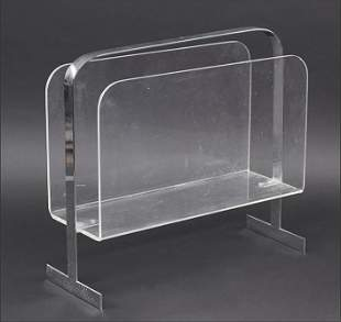 A Milo Baughman Chrome and Lucite Magazine Rack.