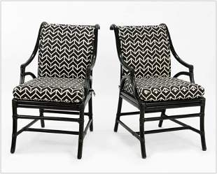 A Set of Four McGuire Black Rattan Chairs.