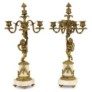 A Pair of French Louis XVI Style Candelabra.